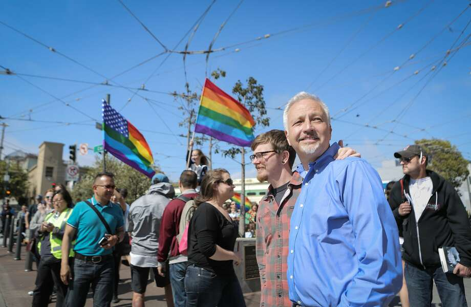Matt Foreman (in blue), Senior Program Director at the Haas Jr. Fund, walks through San Francisco's Castro neighborhood with boyfriend Rob Brambley on Friday, June 26, 2015. Earlier in the day, the Supreme Court declared same-sex marriage legal In all 50 states. The Haas Jr. Fund has been a key player in the fight for marriage equality. Photo: Loren Elliott, The Chronicle