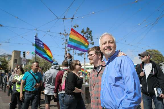 Matt Foreman (in blue), Senior Program Director at the Haas Jr. Fund, walks through San Francisco's Castro neighborhood with boyfriend Rob Brambley on Friday, June 26, 2015. Earlier in the day, the Supreme Court declared same-sex marriage legal In all 50 states. The Haas Jr. Fund has been a key player in the fight for marriage equality.