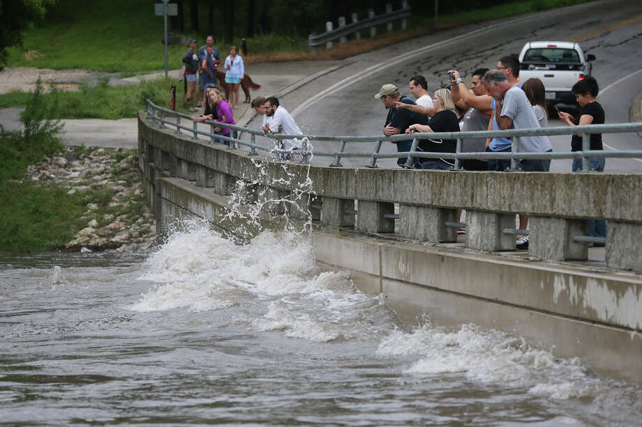 Swift water from heavy afternoon rain brought out the spectators at the Gruene bridge on the Guadalupe River in New Braunfels in May, but the river this weekend will be at more user-friendly levels. Photo: Tom Reel /San Antonio Express-News