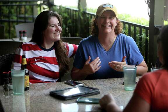 Stephanie Hearn, 25, left, and Theresa Broussard, 45, meet with wedding planner Claudia de Velasco, of A Day to Remember, at Ruggles Green Friday, June 26, 2015, in Houston. Hearn and Broussard, a couple for over three years, plan on being married Oct. 9, 2015 at the Astorian in Houston. The Supreme Court of the United States on Friday ruled that same-sex couples can marry nationwide.  ( Gary Coronado / Houston Chronicle )