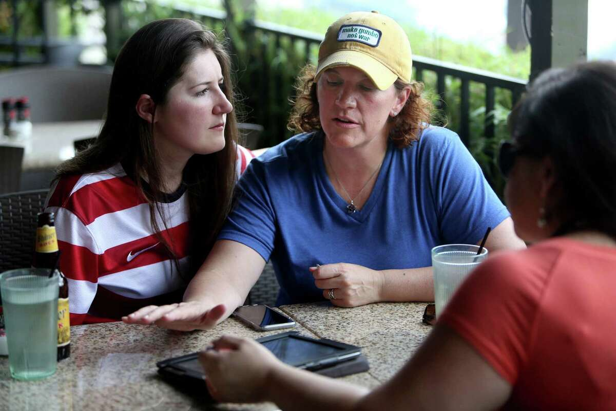 Stephanie Hearn, 25, left, and Theresa Broussard, 45, meet with wedding planner Claudia de Velasco of A Day to Remember on Friday. They plan on being married on Oct. 9.