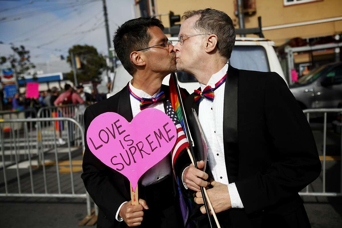 Stuart Gaffney, left, and John Lewis share a kiss to celebrate the US Supreme Court ruling that guarantees Constitutional rights to same-sex marriage, in the Castro district of San Francisco, Calif., on Friday, June 26, 2015. Gaffney and Lewis were two of the plaintiffs in an historic 2008 lawsuit that claimed California's ban on same-sex marriage violated the state's constitution.