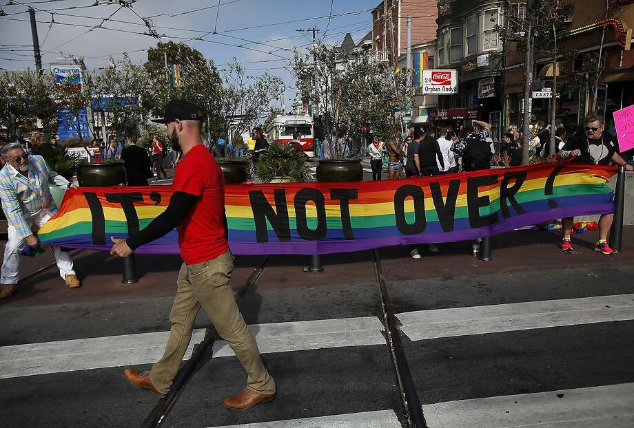 "A banner that says ""It's Not Over"" is unfurled in the Castro in San Francisco, Calif., on Friday, June 26, 2015. Photo: Sarah Rice, Special To The Chronicle"