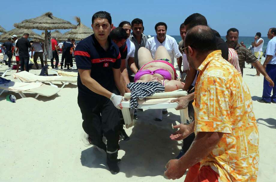A woman receives medical attention Friday after a shooting in Sousse, Tunisia. At least 27 died  in the North African country's worst mass attack in recent history. Photo: FETHI BELAID, Staff / AFP
