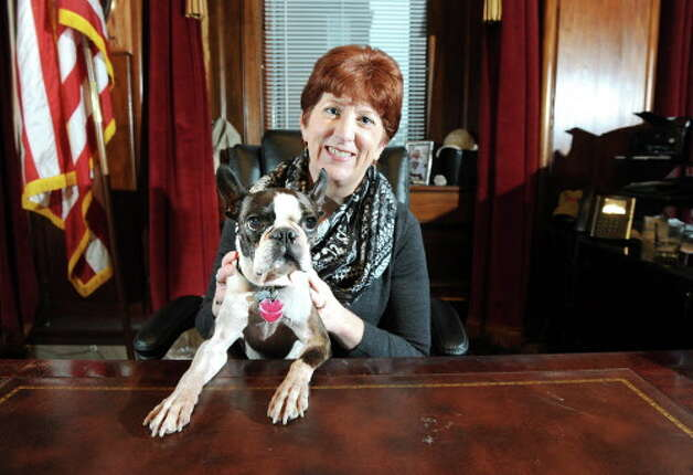 Mayor Kathy Sheehan and her Boston terrier, Ozzy, on Wednesday, Dec. 24, 2014, in the Mayor's office in Albany, N.Y. (Cindy Schultz / Times Union) Photo: Cindy Schultz, Albany Times Union / 00029976A