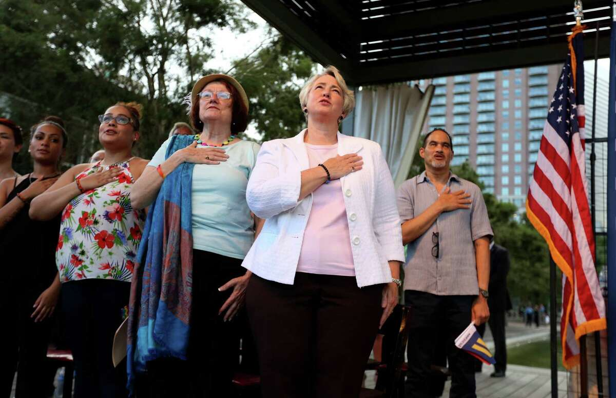 Houston Mayor Annise Parker, second from right, with wife Kathy Hubbard, and daughters Marquitta Parker, 20, far left, and Daniela Parker, 24, before addressing the crowd to celebrate the passage of same sex marriage, at an event hosted by Lambda Legal Houston, Victory Fund Houston, and the Human Rights Campaign, at Discovery Green Friday, June 26, 2015, in Houston. The Supreme Court of the United States on Friday ruled that same-sex couples can marry nationwide.