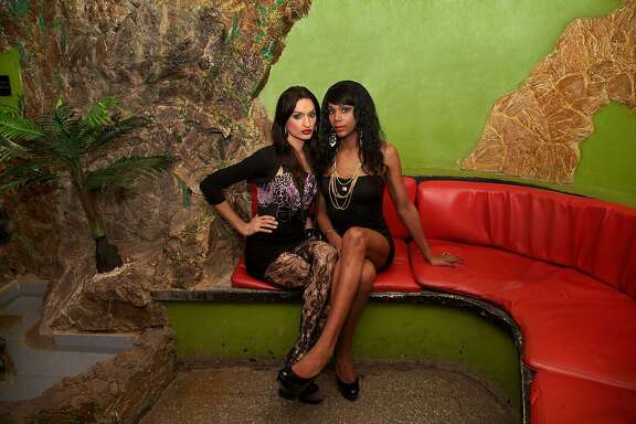 Two women pose at the Las Vegas Club in Havana. This is the place where Mariette Pathy Allen first began photographing trans women living in Cuba.