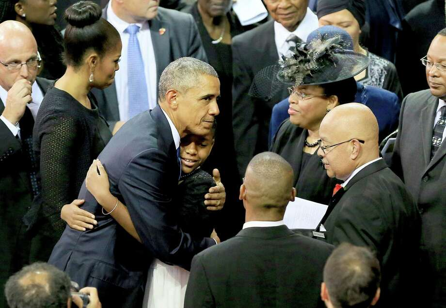 President Barack Obama on Friday embraces relatives of Sen. Clementa Pinckney, who was killed during the mass church shooting in South Carolina.  Photo: Pool / 2015 Getty Images
