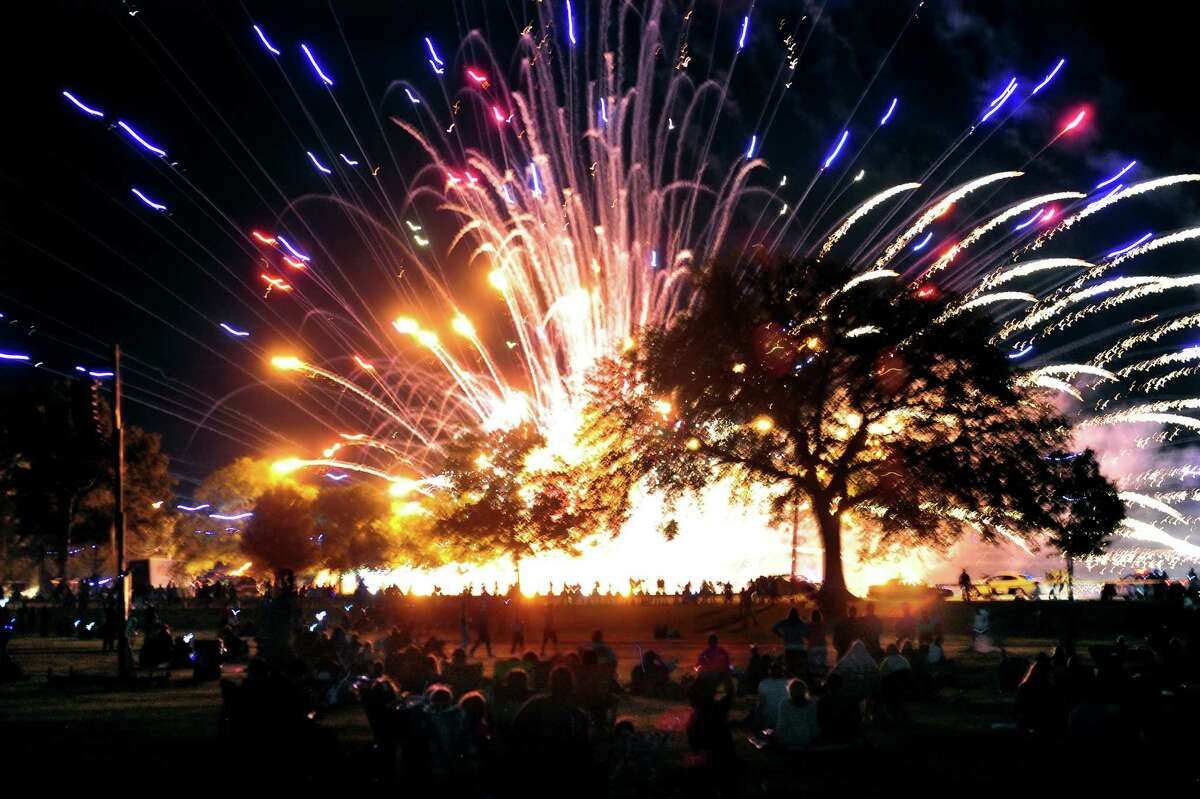 The sky and ground is illuminated during the Barnum Skyblast Fireworks display at Seaside Park in Bridgeport, Conn., on Friday June 26, 2015. The Greater Bridgeport Symphony Pops Concert preceded the fireworks, led by Maestro Eric Jacobsen.