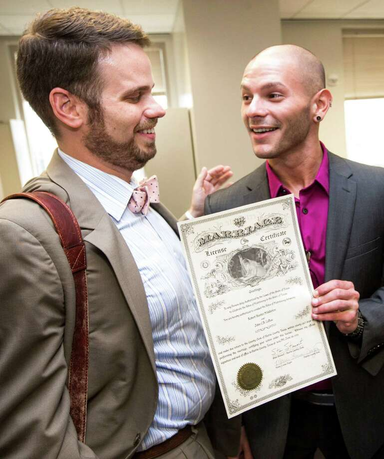 John LaRue, left, and Hunter Middleton proudly receive their marriage license on Friday. Photo: Brett Coomer, Staff / © 2015 Houston Chronicle