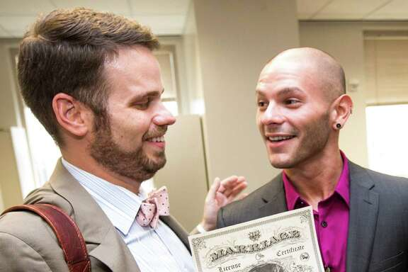 John LaRue, left, and Hunter Middleton proudly receive their marriage license on Friday.