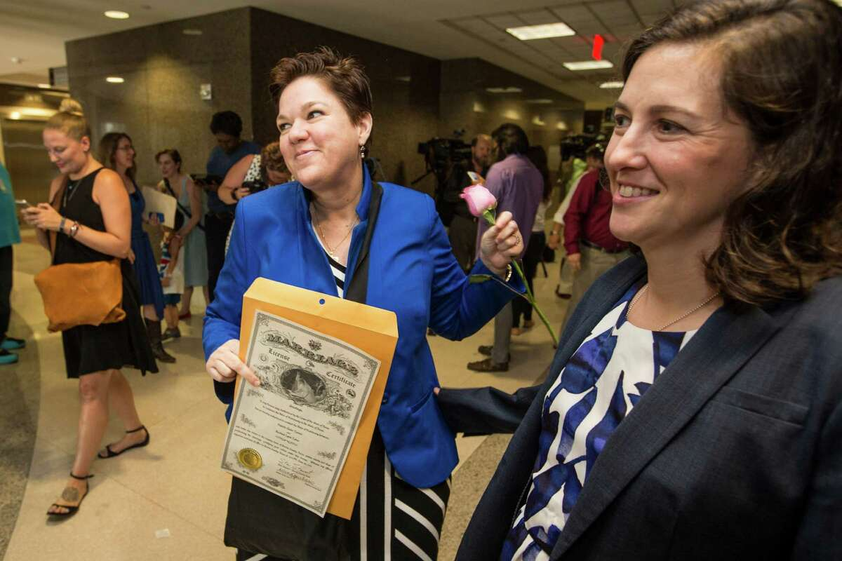Valerie Turner, left, and Rachel Tobor celebrate the historic ruling Friday by being issued their marriage license at the Harris County Clerk's Office.