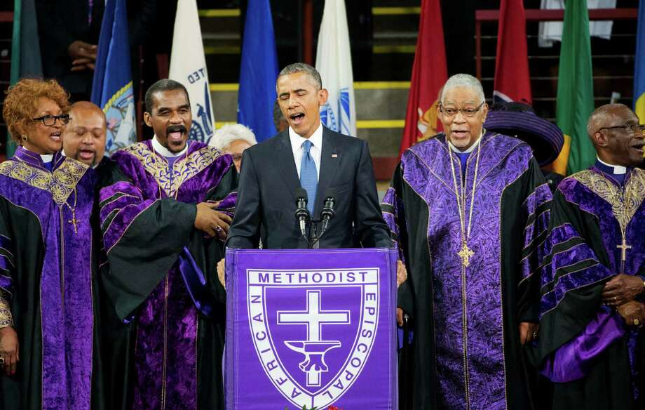 """President Barack Obama sings """"Amazing Grace"""" during services Friday honoring the Rev. Clementa Pinckney. Obama named each of the nine victims of the South Carolina church shooting in the eulogy and praised Gov. Nikki Haley for advocating removal of the Confederate flag. Photo: David Goldman, STF / AP"""