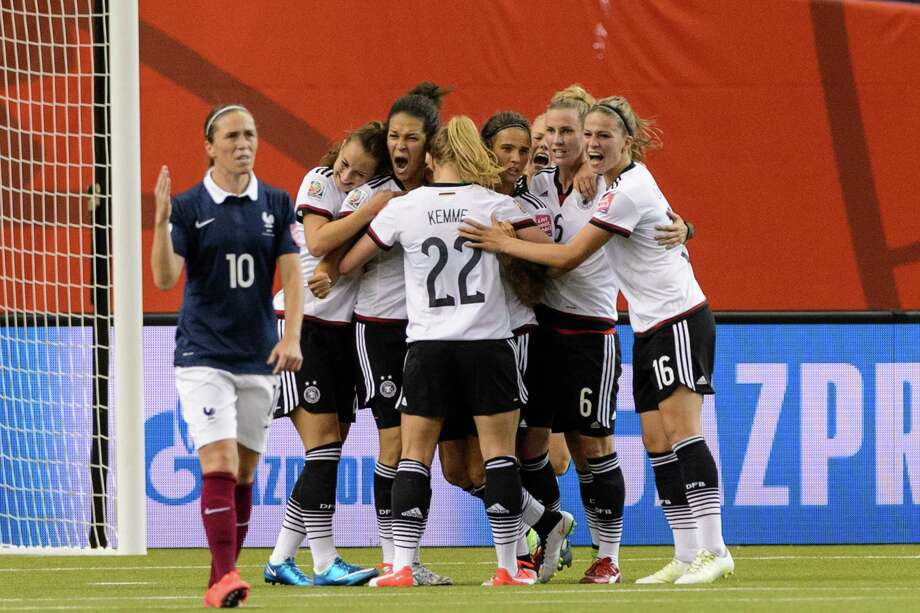 The German team celebrates a goal by Celia Sasic in the 84th minute that tied the match and forced a shootout with France. Sasic then converted the penalty kick that gave Germany a lead it didn't relinquish. Photo: Minas Panagiotakis, Stringer / 2015 Getty Images