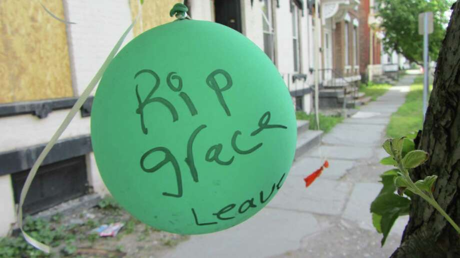 A balloon outside 520 Second Ave. in Lansingburgh on Tuesday, May 26, 2015, marks the passing of Grace Halpin. (Bob Gardinier/Times Union)