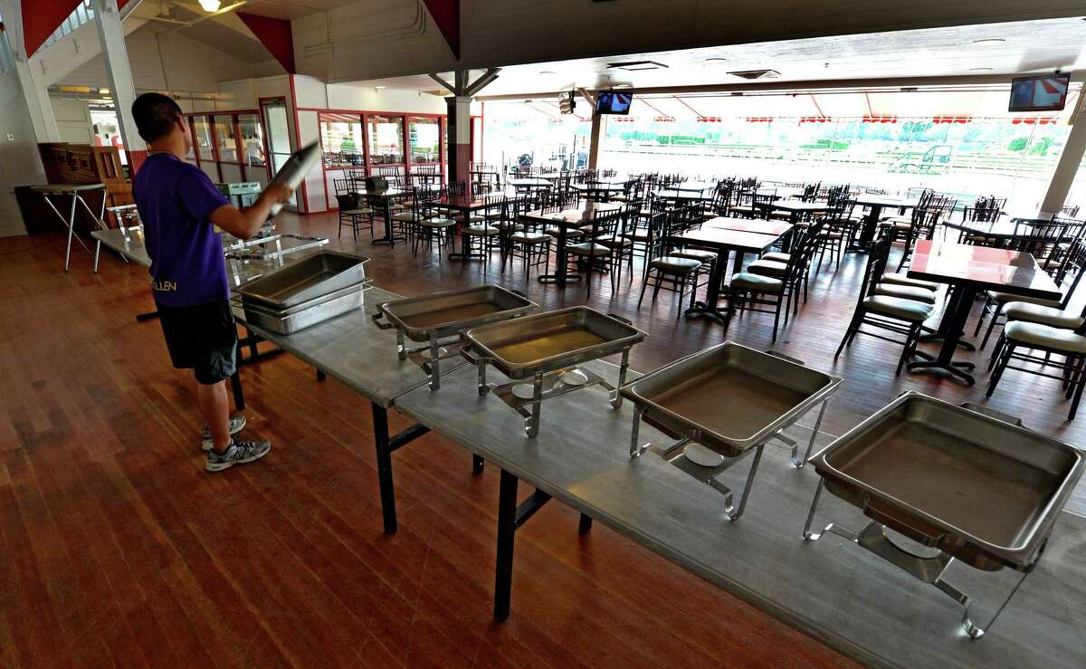 Porter Kimo Pabulayan puts out the equipment to be used for the Saratoga Sunrise breakfast at Saratoga Race Course Thursday morning, July 17, 2014, in Saratoga Springs, N.Y. (Skip Dickstein / Times Union archive)