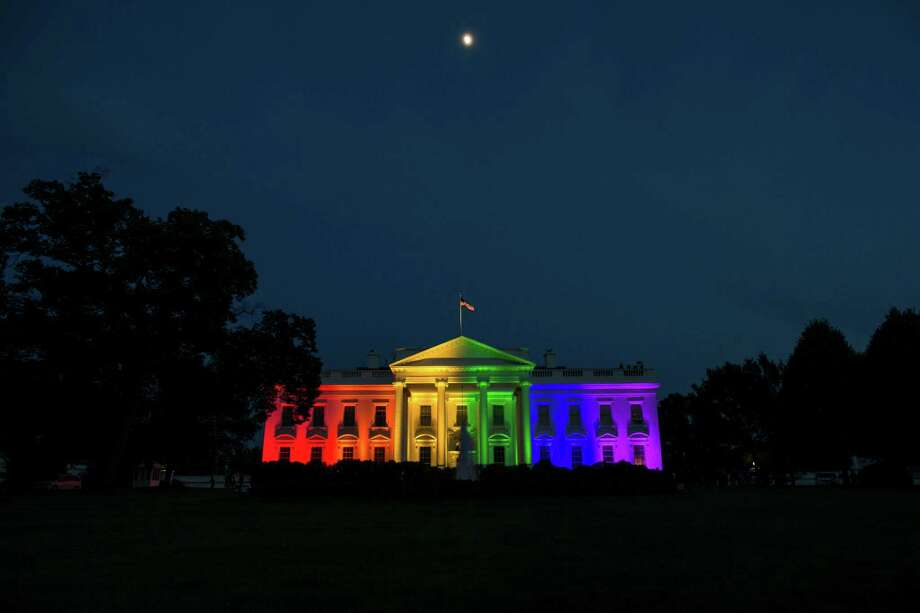 Rainbow colored lights illuminate the White House in honor of the Supreme Court ruling allowing same-sex marriage in all 50 states, in Washington, June 26, 2015. In a long-sought victory for the gay rights movement, the Supreme Court ruled Friday that the Constitution guarantees a nationwide right to same-sex marriage.  (Zach Gibson/The New York Times) Photo: ZACH GIBSON, STF / New York Times / NYTNS