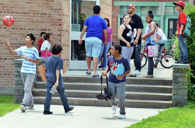 Children leave school on last day of the year at Giffen Memorial Elementary School Friday June 26, 2015 in Albany, NY.  (John Carl D'Annibale / Times Union) Photo: John Carl D'Annibale / 00032405A