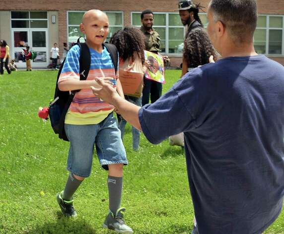 Eight-year-old Donovan Dickerson runs into the waiting arms of his dad Karl Dickerson on last day of the year at Giffen Memorial Elementary School Friday June 26, 2015 in Albany, NY.  (John Carl D'Annibale / Times Union) Photo: John Carl D'Annibale / 00032405A