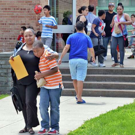Dawn Davis, left, comforts her son Rondell Etheridge, 11,  on last day of the year at Giffen Memorial Elementary School Friday June 26, 2015 in Albany, NY.  (John Carl D'Annibale / Times Union) Photo: John Carl D'Annibale / 00032405A