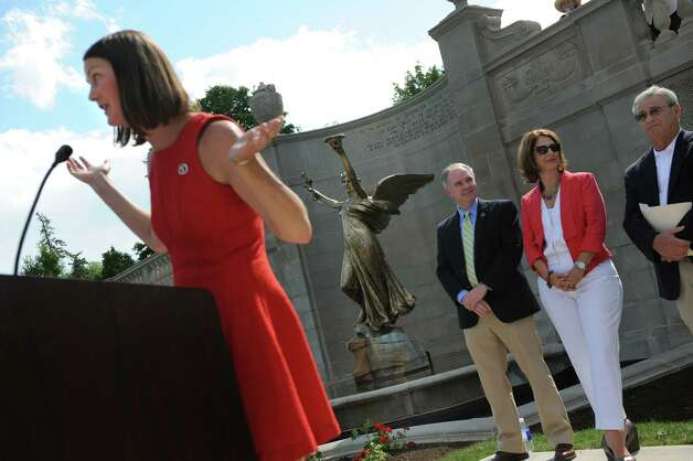 Samantha Bosshart, executive director of the Saratoga Springs Preservation Foundation, left, speaks during the centennial rededication ceremony of the Spirit of Life and Spencer Trask Memorial on Friday, June 26, 2015, at Congress Park in Saratoga Springs, N.Y. (Cindy Schultz / Times Union) Photo: Cindy Schultz / 00032389A