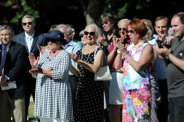 "The audience applauds when a small group sings an impromptu verision of ""Happy Birthday"" for the Spirit of Life and Spencer Trask Memorial during the centennial rededication ceremony on Friday, June 26, 2015, at Congress Park in Saratoga Springs, N.Y. (Cindy Schultz / Times Union) Photo: Cindy Schultz / 00032389A"