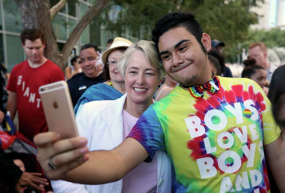 Angel Cixco, 15, of Houston, takes a selfie with Houston Mayor Annise Parker as they celebrate the passage of same sex marriage, at an event hosted by Lambda Legal Houston, Victory Fund Houston, and the Human Rights Campaign, at Discovery Green Friday, June 26, 2015, in Houston. The Supreme Court of the United States on Friday ruled that same-sex couples can marry nationwide. Photo: Gary Coronado, Houston Chronicle / © 2015 Houston Chronicle