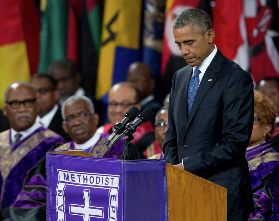 President Barack Obama pauses as he speaks during services honoring the life of Rev. Clementa Pinckney, Friday, June 26, 2015, at the College of Charleston TD Arena in Charleston, S.C.. Pinckney was one of the nine people killed in the shooting at Emanuel AME Church last week in Charleston. (AP Photo/Carolyn Kaster) ORG XMIT: SCCK133 Photo: Carolyn Kaster / AP