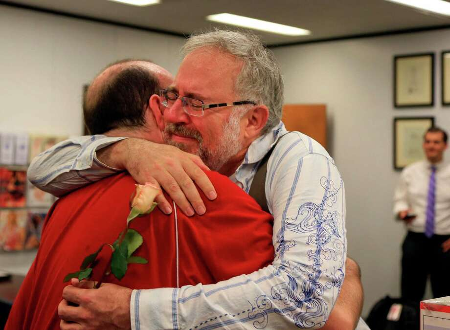 Christopher Brown, left, and Tom Fennell hug after getting their marriage license at the Douglas County County Clerk's office in Omaha, Neb., Friday, June 26, 2015. Gay couples in Nebraska will now have their marriages legally recognized now that the U.S. Supreme Court declared Friday that same-sex couples have a right to marry anywhere in the United States. (AP Photo/Nati Harnik) ORG XMIT: NENH104 Photo: Nati Harnik / AP
