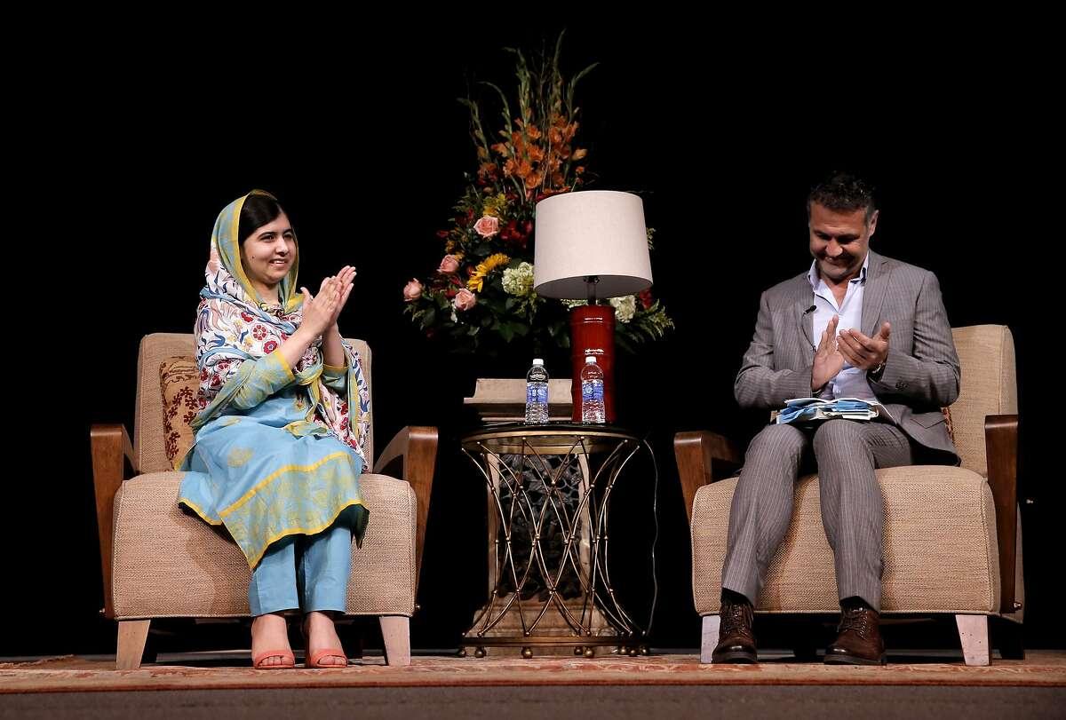 Nobel Laureate, Malala Yousafzai speaks with Kite Runner author Khaled Hosseini as a crowd of nearly 4,000 attend, at the San Jose State Events Center on Fri. June 26, 2015, in San Jose , Calif.