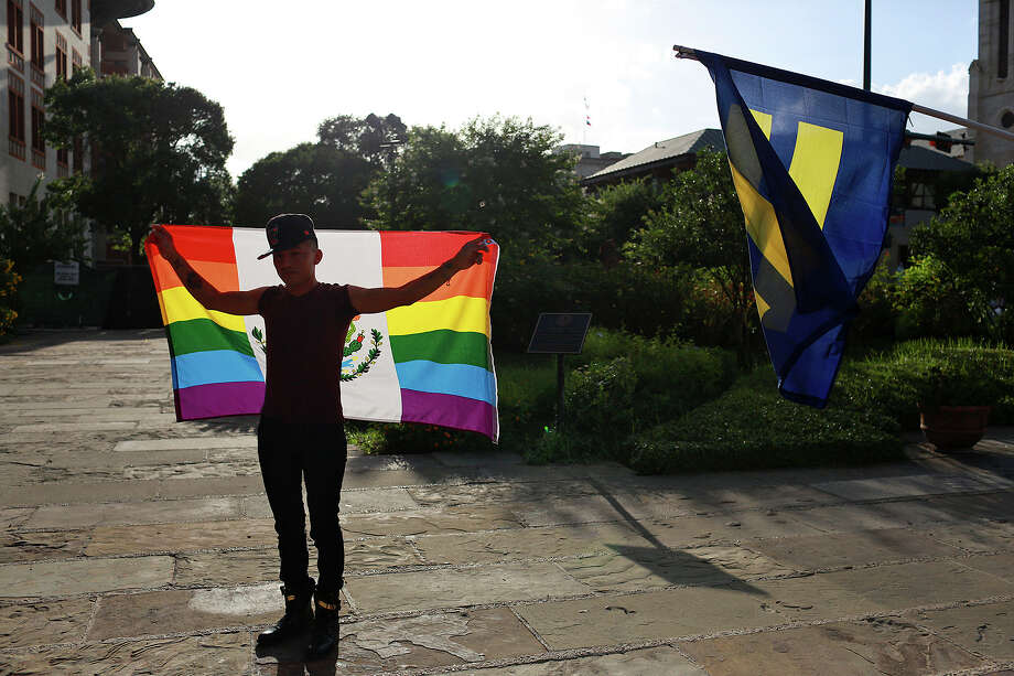 Carlos Frias celebrates the U.S. Supreme Court's decision to legalize gay marriage nationwide during a rally in front of the Bexar County Courthouse on Friday, June 26, 2015. Photo: Lisa Krantz, Staff / San Antonio Express-News / ©2015 San Antonio Express-News