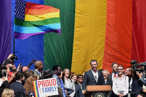 Gavin Newsom, lieutenant governor of California, speaks during a news conference outside City Hall after the U.S. Supreme Court same-sex marriage ruling in San Francisco, California, U.S., on Friday, June 26, 2015. Same-sex couples have a constitutional right to marry nationwide, the U.S. Supreme Court said in a historic ruling that caps the biggest civil rights transformation in a half-century. Photographer: Josh Edelson/Bloomberg *** Local Caption *** Gavin Newsom