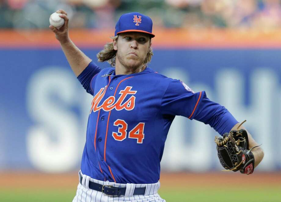 New York Mets' Noah Syndergaard delivers a pitch during the first inning of a baseball game against the Cincinnati Reds on Friday, June 26, 2015, in New York. (AP Photo/Frank Franklin II) ORG XMIT: NYM102 Photo: Frank Franklin II / AP