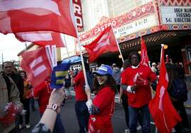 Participants in the Day of Decision rally hand out flags in the Castro in San Francisco, Calif., on Friday, June 26, 2015.