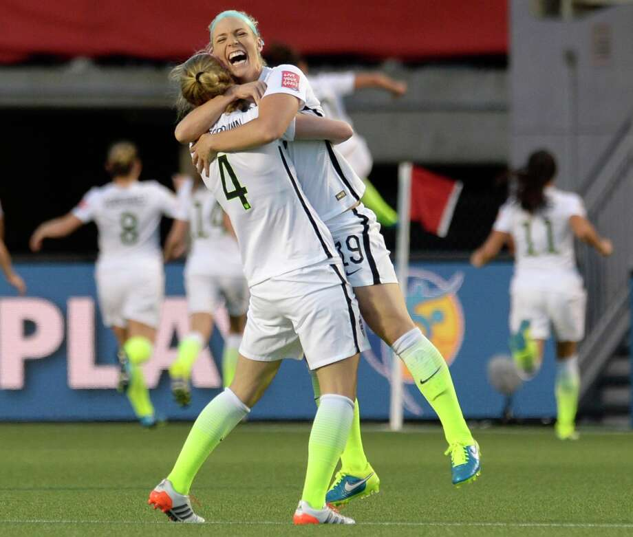 Becky Sauerbrunn, left, and Julie Johnston, who set up the only score of the match, celebrate Carli Lloyd's second-half goal that lifted the U.S. past China on Friday in the quarterfinals. Photo: Adrian Wyld, SUB / The Canadian Press