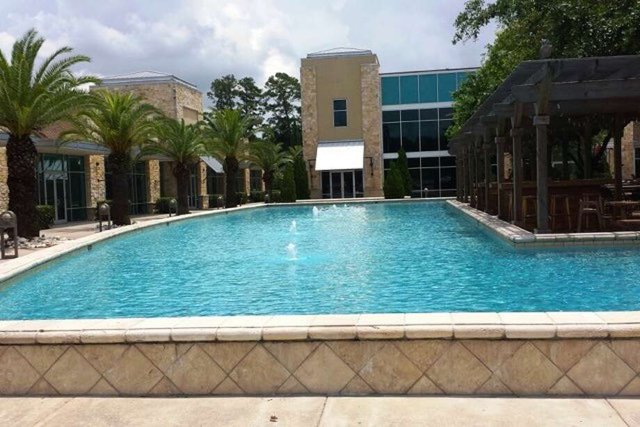 Woodside Health has acquired the Alore Center, a building near The Woodlands that's home to a surgery center and a branch of the Houston Association of Realtors.