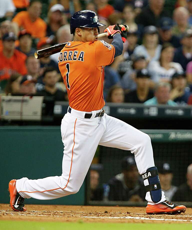Astros shortstop Carlos Correa snaps an 0-for-7 skid by producing a run-scoring single in the third inning Friday night. Photo: James Nielsen, Staff / © 2015  Houston Chronicle
