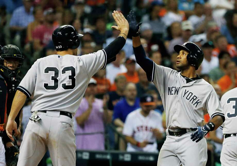HOUSTON, TX - JUNE 26:  Chris Young #24 and Garrett Jones #33 of the New York Yankees celebrate after Young hit a three-run home run in the seventh inning during their game against the Houston Astros at Minute Maid Park on June 26, 2015 in Houston, Texas.  (Photo by Scott Halleran/Getty Images) ORG XMIT: 538584465 Photo: Scott Halleran / 2015 Getty Images