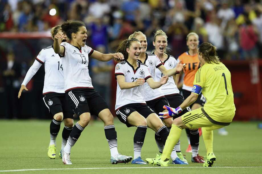 MONTREAL, QC - JUNE 26:  Nadine Angerer of Germany celebrates with team mates as she saves the final penalty during the FIFA Women's World Cup Canada 2015 Quarter Final match between Germany and France at Olympic Stadium on June 26, 2015 in Montreal, Canada.  (Photo by Dennis Grombkowski/Bongarts/Getty Images) ORG XMIT: 528452917 Photo: Dennis Grombkowski / 2015 Getty Images