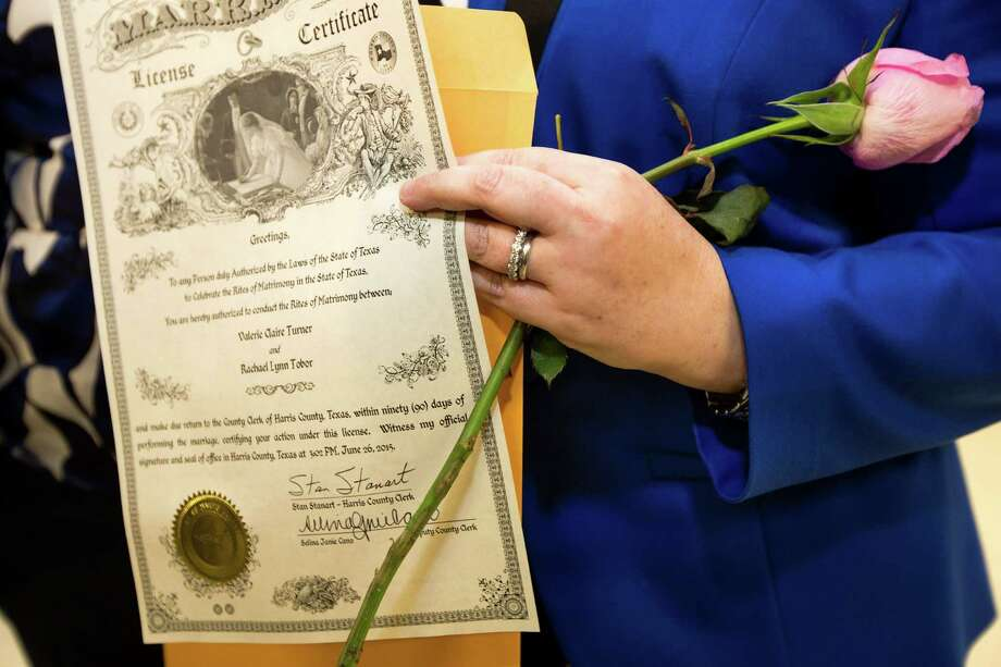 Rachel Tobor holds her new marriage license at the Harris County Clerk's office on Friday, June 26, 2015, in Houston. In a 5-4 decision, the Supreme Court legalized same-sex marriage nationwide, striking down the remaining bans in Texas and a dozen other states. Photo: Brett Coomer, Houston Chronicle / © 2015 Houston Chronicle