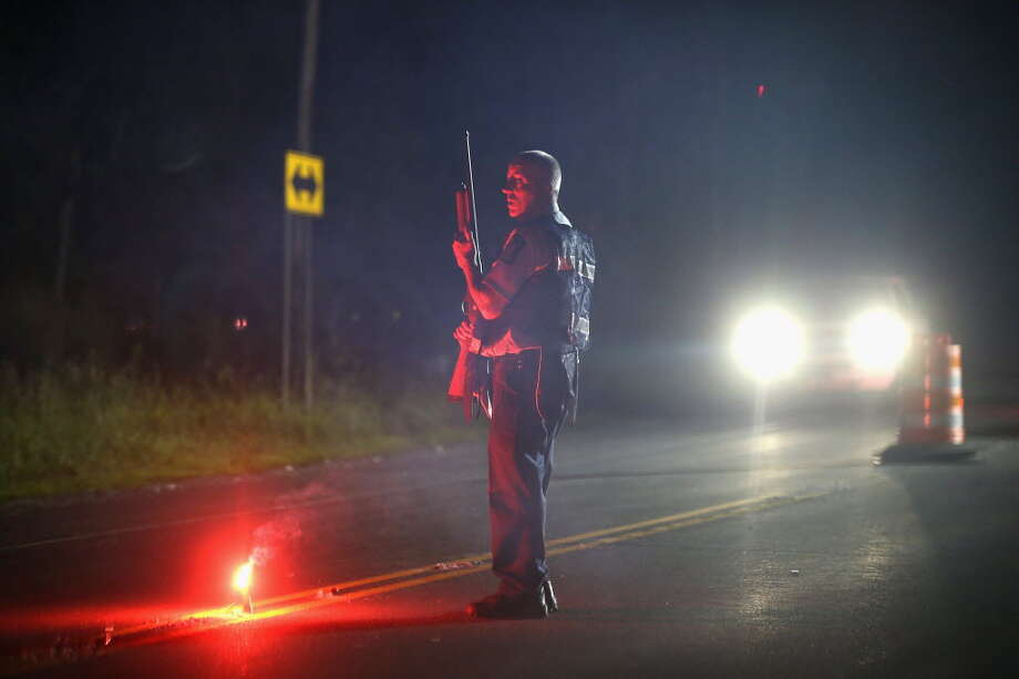 MALONE, NY - JUNE 26: A Department of Correction officer mans a roadblock near the scene where escaped convict Richard Matt was shot and killed by law enforcement officers who had been hunting for him and fellow escapee David Sweat on June 26, 2015 in Malone, New York. Police have been searching for Matt and Sweat since they were discovered missing from a prison in nearby Dannemora on June 6. According to authorities Sweat is still at large in the area. (Photo by Scott Olson/Getty Images)