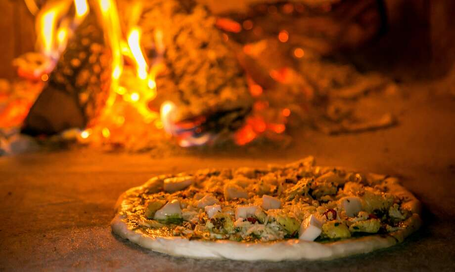 Cauliflower with nettle pesto pizza in the wood burning oven at Parlour in Oakland. Photo: John Storey, Special To The Chronicle