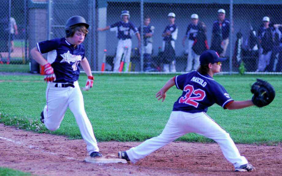 Westport's Alex Deutsch beats out a throw to first base during a Little League baseball game on Friday, June 26, 2015. Westport defeated Fairfield National 13-8. Photo: Ryan Lacey/Staff Photo / Westport News Contributed