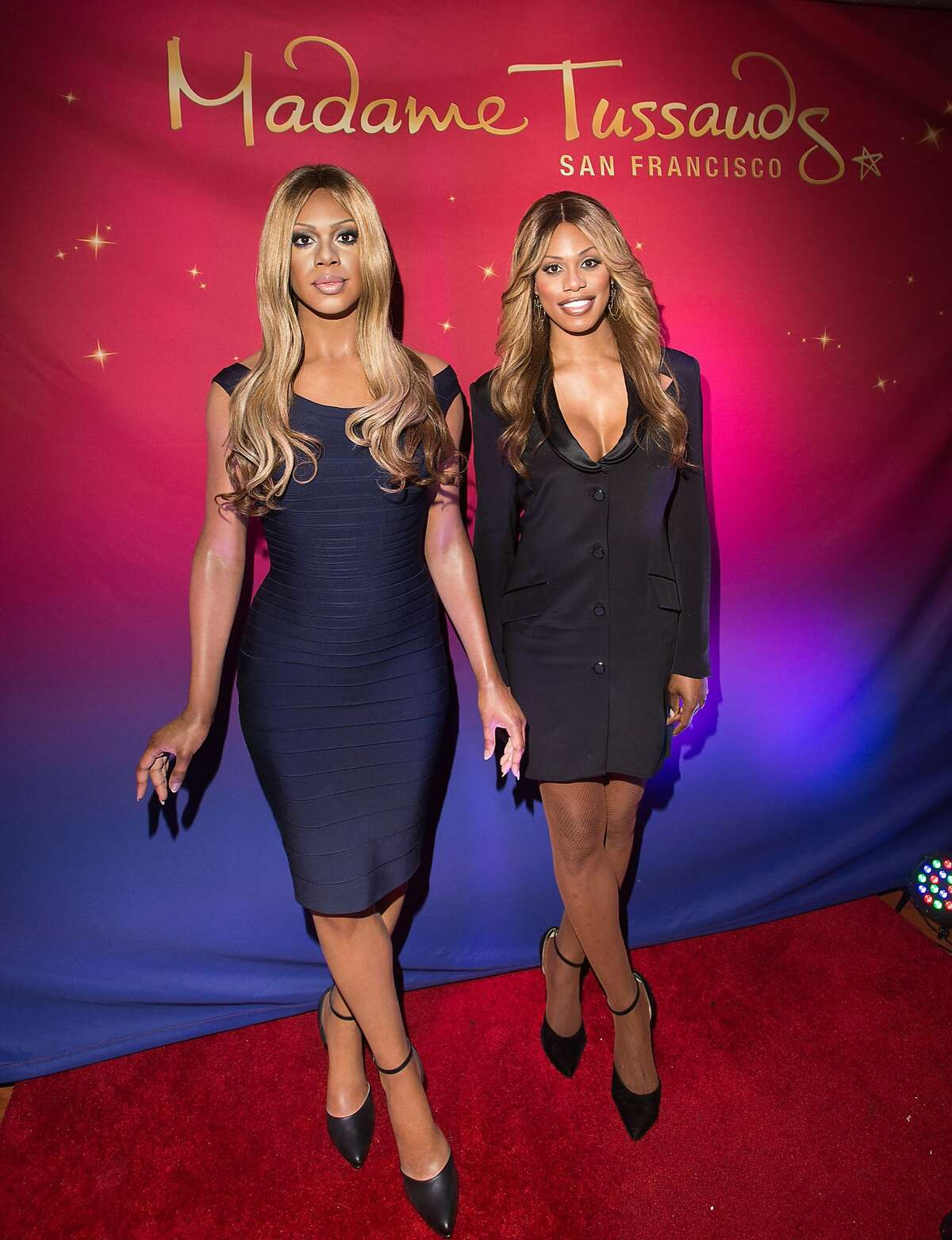 In this image provided by Madame Tussauds, actress Laverne Cox, right, unveils her wax figure on Friday, June 26, 2015, in San Francisco. Cox, who stars in the Netflix series