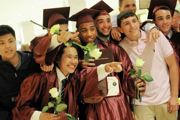 Graduates smile for the camera at the Colonie High School graduation on Friday, June 26, 2015, at the Empire State Plaza Convention Center in Albany, N.Y. (Cindy Schultz / Times Union) Photo: Cindy Schultz / 00032178A