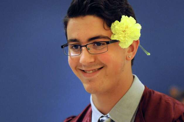 Graduate Alexander Mastroianni, 17, sports a carnation at the Colonie High School graduation on Friday, June 26, 2015, at the Empire State Plaza Convention Center in Albany, N.Y. (Cindy Schultz / Times Union) Photo: Cindy Schultz / 00032178A
