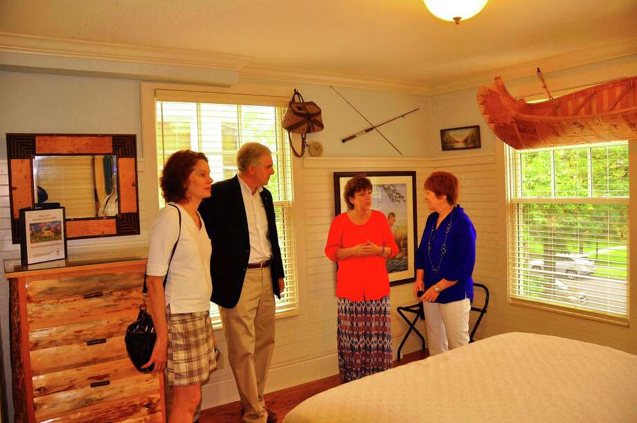 Albany Mayor Kathy Sheehan, right, talks with Debbie Ross, second from right, the resident director of Ronald McDonald House in Albany in the charity's new house at 141 S. Lake Ave. in Albany on Saturday, June 27, 2015. With them are, from left, Assemblywoman Patricia Fahy and Albany City Treasurer Darius Shahinfar. (Photo by Steve Barnes/Times Union)