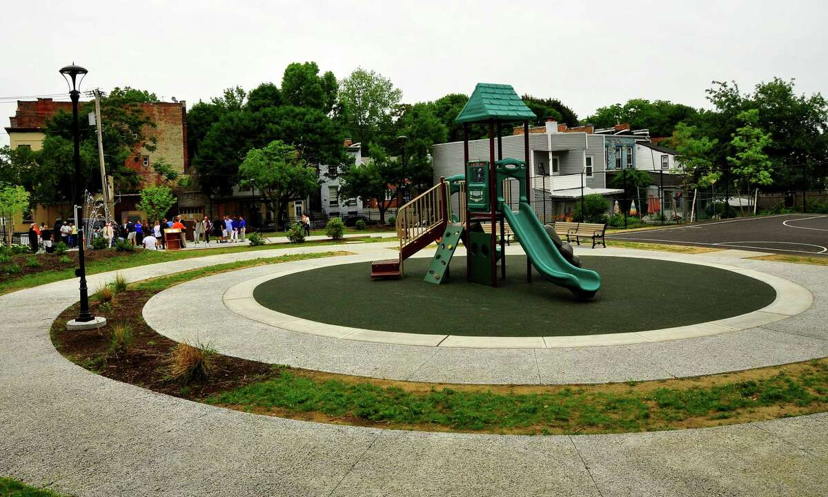 Designed as a multi-use outdoor community center, the new North Swan Street Park in Albany has half-court basketball, playground equipment, benches and tables, a spray pad for water fun and a small amphitheater. It was unveiled on Saturday, June 27, 2015. (Steve Barnes/Times Union)