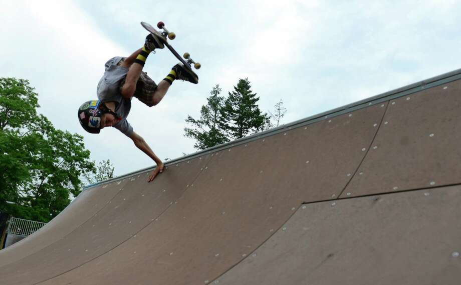 Martin Curley, 14, of Greenwich, does an aerial trick on a half pipe while skateboarding with friends at the Greenwich Skatepark located inside Roger Sherman Baldwin Park in Greenwich, Conn., on Tuesday June 23, 2015. Photo: Christian Abraham / Hearst Connecticut Media / Connecticut Post