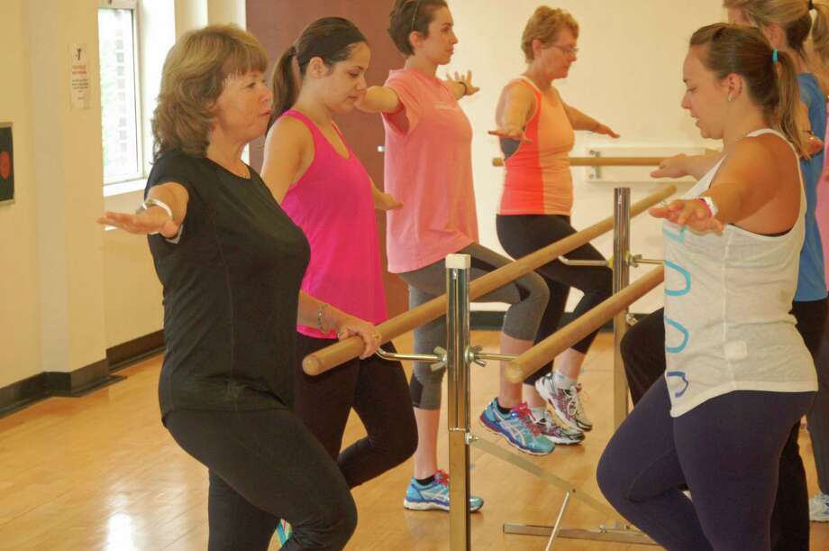 Wendy Lee Rosa, left, goes thorugh an aerobic routine at the YMCA with some friends who dropped by to get a workout. Rosa has created a class to offer support and exercise to women undergoing treatment for or recovering from breast cancer. Photo: Ken Borsuk / Hearst Connecticut Media / Greenwich Time